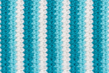 Texture of woolen knitting fabric with vertical stripes