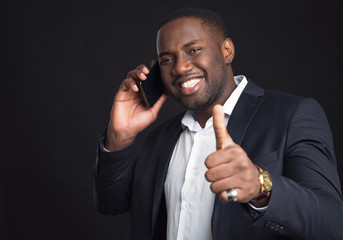 Successful confident black businessman. Handsome african american business man  talking on the smart phone.