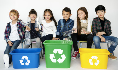 Enviromental conservation children separate garbage for recycle