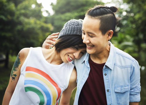 Smiling young couple standing outdoors