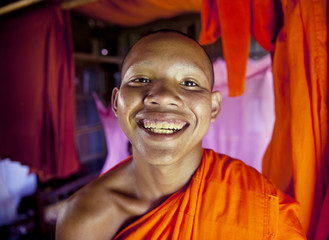 Young smiling Cambodian monk.