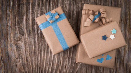 Three handcraft gift boxes on vintage wood