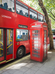 a red bus and typical phone box of London