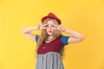 Attractive hipster girl posing on color background