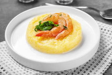 Plate with fresh tasty shrimp and grits on table, closeup