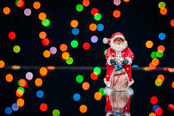 Christmas picture with Santa on a background of colored lights