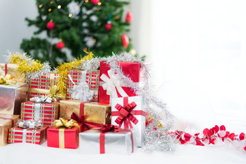 Gift box with Christmas tree background for surprise Children in New year or Xmas party festival. Relaxing holiday and Object concept. Christmas party event and Happy new year theme. Decorate property