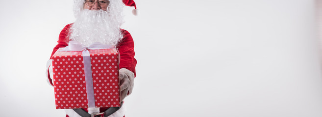 Panoramic image of Santa Claus giving gift box on white background with copy space,Christmas decoration holiday party. Merry Christmas and happy new year concept
