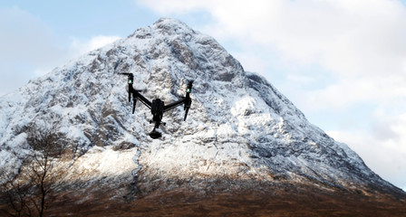 A drone flies at the foot of the mountain Buachaille Etive Mor near Ballachulish, Scotland,