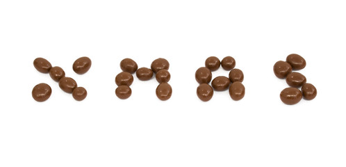 Christmas word written with Chocolate balls isolated on white background