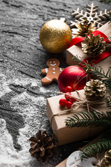 Christmas background with snow and decoration on concrete.