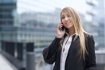 beautiful businesswoman talking to mobile