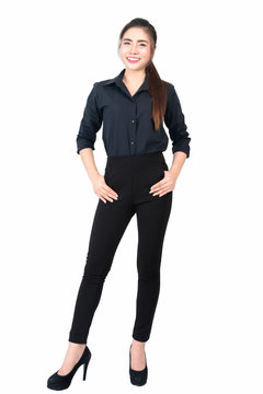Smiling young business woman portrait in black long sleeve and slacks on white background