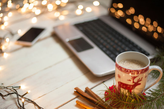 Freelancer's working place at home decorated for Christmas holiday