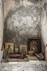 an abandoned church and an altar with small icons and money left. a Christian church and preserved icons. faith in God