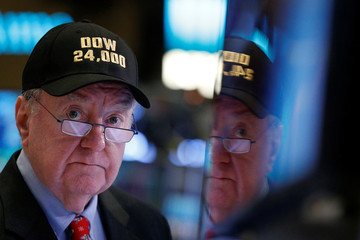 Art Cashin, Director of Floor Operations at UBS, wears a DOW 24,000 hat as he works on the floor of the NYSE as the Dow Jones Industrial Average crosses 24,000, in New York