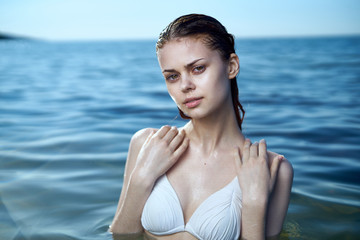 Beautiful young woman is resting on the sea, ocean, sun, summer