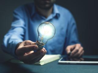 Man showing light bulb. Idea concept