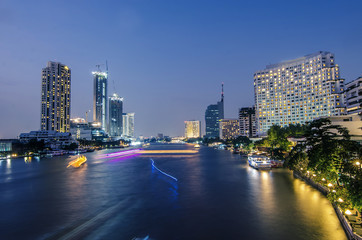 Abstract blurred Background of Light effects over time after sunset on the river : Bangkok city, Hotel and resident area in capital of Thailand