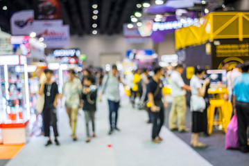 Abstract blurred people walking and shopping in Exhibition Hall.