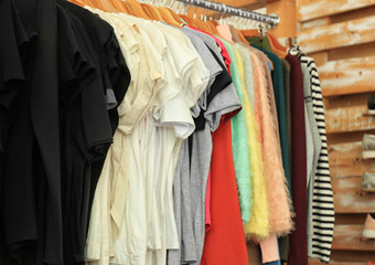 Female clothes on rack in boutique
