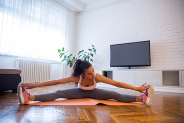 Young woman workout in the room