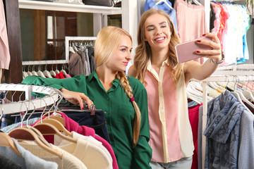 Young women taking selfie in modern shop