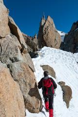 Foto op Aluminium Alpinisme Climbing in Chamonix. Climber on the snowy ridge of Aiguille du Midi