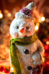 glitter snowman ornament in warm bokeh lights