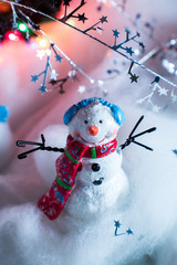 smiling snowman decoration with winter Christmas scene