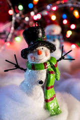 Christmas snowman in top hat decoration with bokeh lights