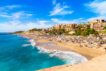 Summer holiday on El Duque beach in Tenerife, famous Adeje coast on Canary island, Spain Wall mural