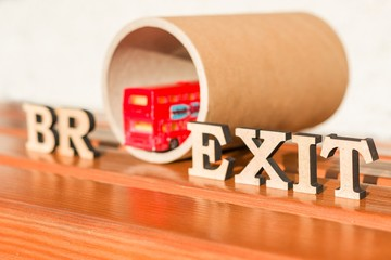 Britain exit from European Union, Brexit word abstract in vintage letters,background double decker bus toy model, tunnel
