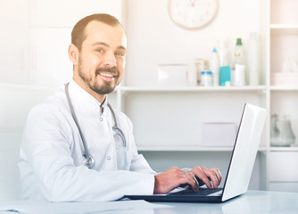 Man doctor working effectively in his office