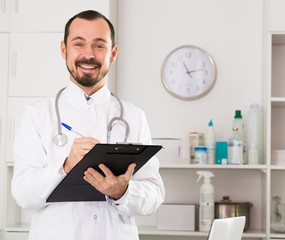 Male doctor waiting for patients