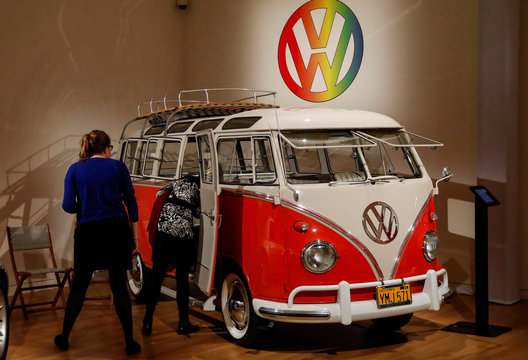"Guests looks at a 1960 Volkswagen Deluxe ""23-Window"" Microbus displayed during a media preview for the ""RM Sotheby's Icons"" sale at Sotheby's in New York"