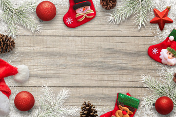 Christmas background for copy text. Christmas decorations, socks, pinecones and fir branches composition. Top view.