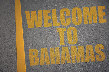 asphalt road with text welcome to bahamas near yellow line.
