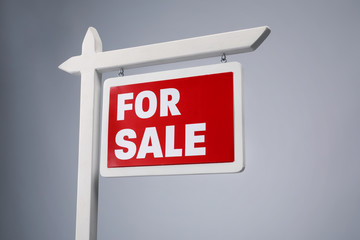 """For sale"" sign on grey background"