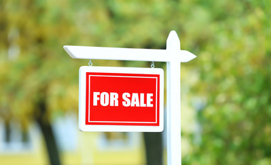 """For sale"" sign outdoors"