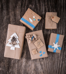 Handmade paper present boxes on rustic wood