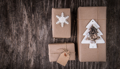Christmas gift boxes collection on rustic wood and copy space