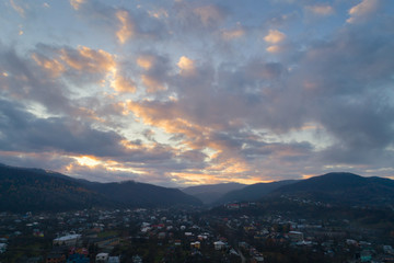 Small town in Carpathian Mountains at sunset.