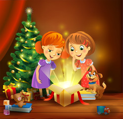 Christmas miracle - girls opening a magic gift beside a Christmas tree
