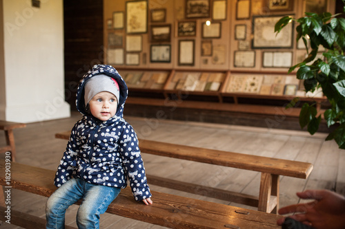 Fine The Baby Sits On A Wooden Bench Inside The Museum Stock Lamtechconsult Wood Chair Design Ideas Lamtechconsultcom