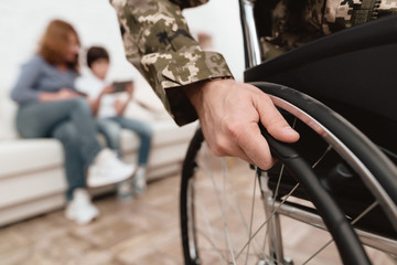 Veteran in wheelchair returned from army. Close-up photo veteran in a wheelchair.