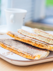 Bolo levedo, typical bread from Azores, grilled with cheese and choriso