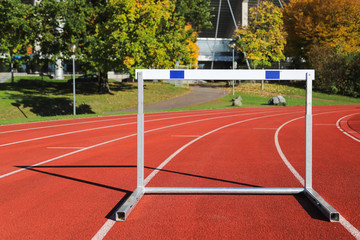 Athletic track with hurdle