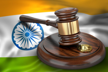 Bitcoin and judge gavel laying on flag of India. Bitcoin legal situation in India concept. 3D rendering