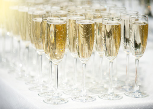 A number of glasses full of champagne